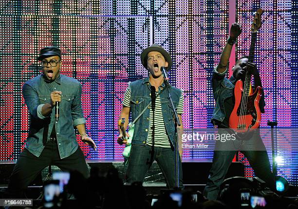 Singer/songwriter Philip Lawrence recording artist Bruno Mars and bassist Jamareo Artis perform during the Hooligans in Wondaland tour at The Pearl...