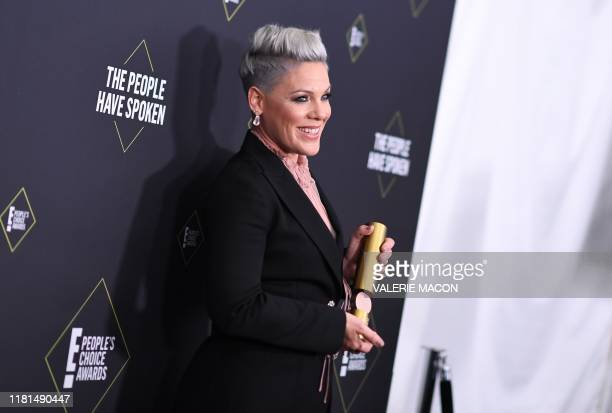 US singer/songwriter Pink poses with the Peoples Champion Award during the 45th annual E People's Choice Awards at Barker Hangar in Santa Monica...