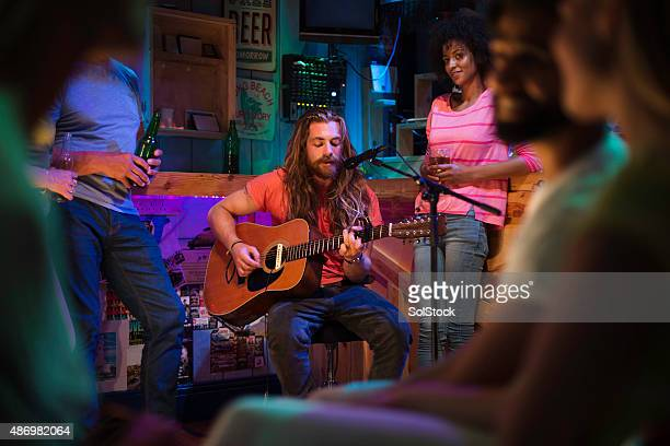 singer/songwriter playing in local bar - songwriter stock pictures, royalty-free photos & images
