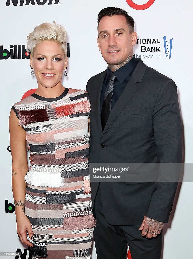 Singer-songwriter P!nk and motorcycle racer Carey Hart attend the 2013 Billboard Annual Women in Music Event at Capitale on December 10, 2013 in New York City.