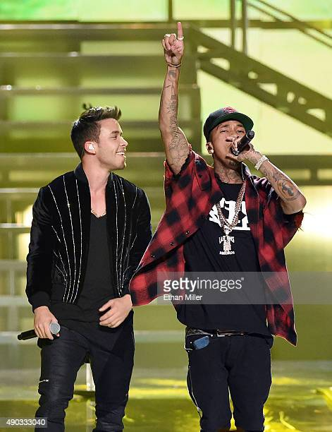 Singer/songwriter Prince Royce and rapper Tyga perform at the 2015 iHeartRadio Music Festival at MGM Grand Garden Arena on September 19 2015 in Las...