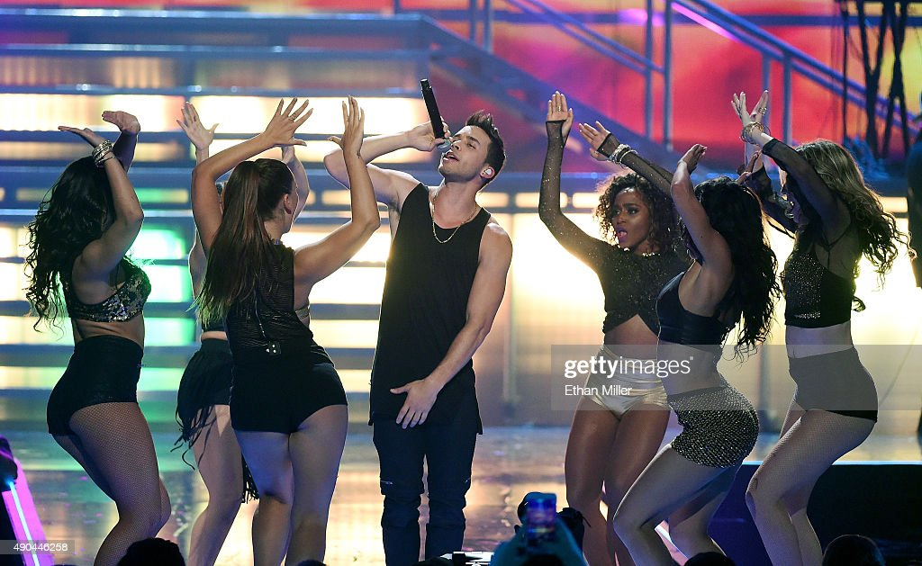 Singer/songwriter Prince Royce (C) performs with dancers at the 2015 iHeartRadio Music Festival at MGM Grand Garden Arena on September 19, 2015 in Las Vegas, Nevada.