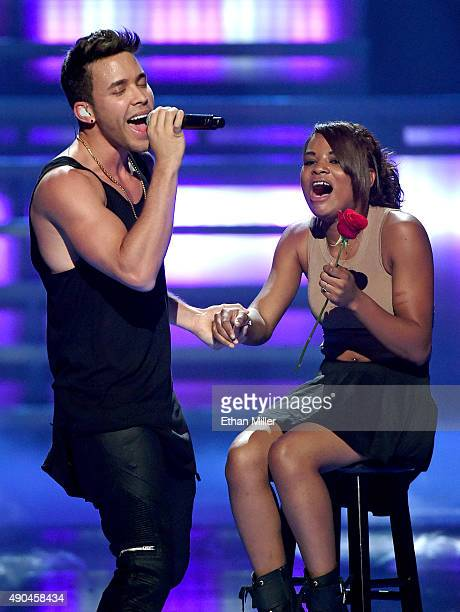 Singer/songwriter Prince Royce sings to a fan as he performs at the 2015 iHeartRadio Music Festival at MGM Grand Garden Arena on September 19 2015 in...