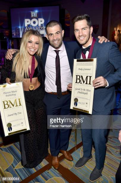 Singersongwriter Rachel Platten Ben Singer CEO of SMG Entertainment and recording artist Andy Grammer at the Broadcast Music Inc honors Barry Manilow...