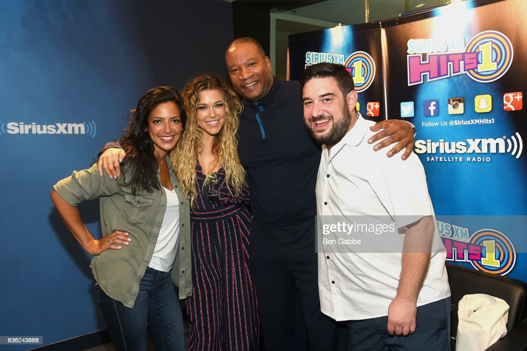 Singer/songwriter Rachel Platten (2L) visits 'The Morning Mash Up' on SiriusXM Hits 1 with hosts (L-R) Nicole Ryan, Stanley T and Ryan Simpson at SiriusXM Studios on August 21, 2017 in New York City.
