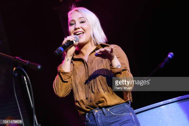 Singersongwriter RaeLynn performs during the CMA's 60th Anniversary Celebration at Wildhorse Saloon on September 26 2018 in Nashville Tennessee