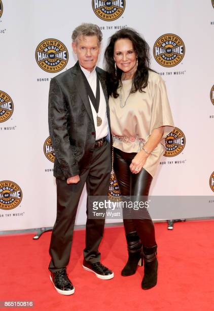 Singersongwriter Randy Travis and Mary Davis attend the Medallion Ceremony to celebrate 2017 hall of fame inductees Alan Jackson Jerry Reed And Don...