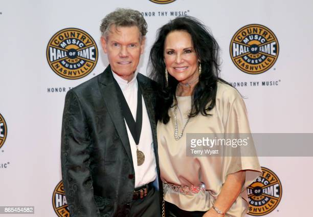 Singersongwriter Randy Travis and Mary Travis attend the Medallion Ceremony to celebrate 2017 hall of fame inductees Alan Jackson Jerry Reed And Don...