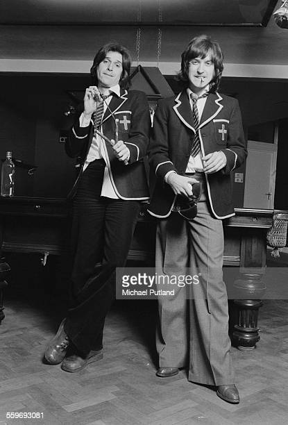 Singersongwriter Ray Davies and his brother guitarist Dave Davies of English pop group The Kinks dressed as schoolboys 20th January 1976 Ray is...
