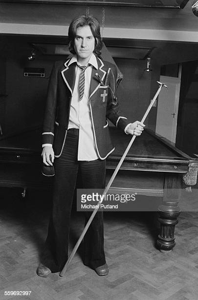 Singersongwriter Ray Davies of English pop group The Kinks posing in a pool room dressed as a schoolboy 20th January 1976 He is promoting the album...