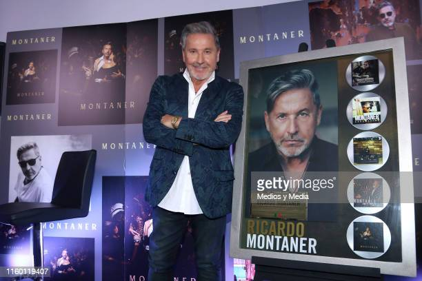 Singersongwriter Ricardo Montaner poses with his recognition for record sales during a press conference at Casa Lucerna on July 4 2019 in Mexico City...