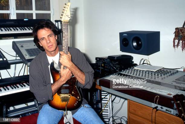 Singer-songwriter Rick Springfield poses holding an electric guitar during a portrait session in his home studio in circa1990 in Los Angeles,...