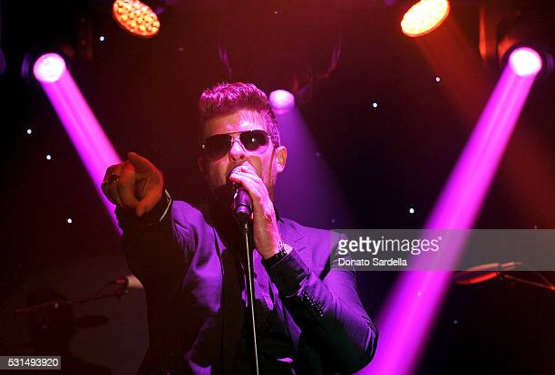 Singersongwriter Robin Thicke performs onstage during the MOCA Gala 2016 at The Geffen Contemporary at MOCA on May 14 2016 in Los Angeles California