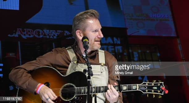 """Singer/songwriter Rory Feek performs during the """"Outside the Barrel"""" with Flint Rasmussen show during the National Finals Rodeo's Cowboy Christmas at..."""