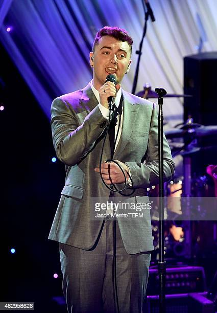 Singersongwriter Sam Smith performs onstage at the PreGRAMMY Gala and Salute To Industry Icons honoring Martin Bandier at The Beverly Hilton Hotel on...