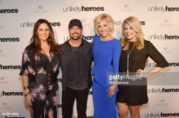 Singersongwriter Sara Evans CMT Host Cody Alan actress Savannah Chrisley and Founder and CEO of Unlikely Heroes Erica Greve take photos on carpet for...