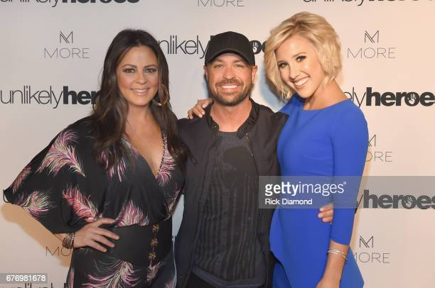 Singersongwriter Sara Evans CMT Host Cody Alan and actress Savannah Chrisley take photos on carpet for Unlikely Heroes hosts Night of Freedom A...
