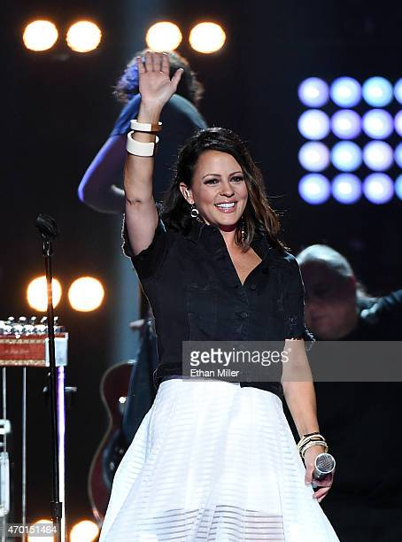 Singer/songwriter Sara Evans performs onstage during ACM Presents Superstar Duets at Globe Life Park in Arlington on April 17 2015 in Arlington Texas