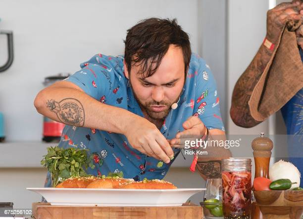 Singersongwriter Shakey Graves assists chef Aaron Sanchez at 'Johnny Sanchez Classics' during the Austin FOOD WINE Festival at Auditorium Shores on...