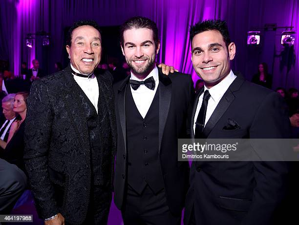 Singer/songwriter Smokey Robinson actor Chace Crawford and manager Eric Podwall attend the 23rd Annual Elton John AIDS Foundation Academy Awards...