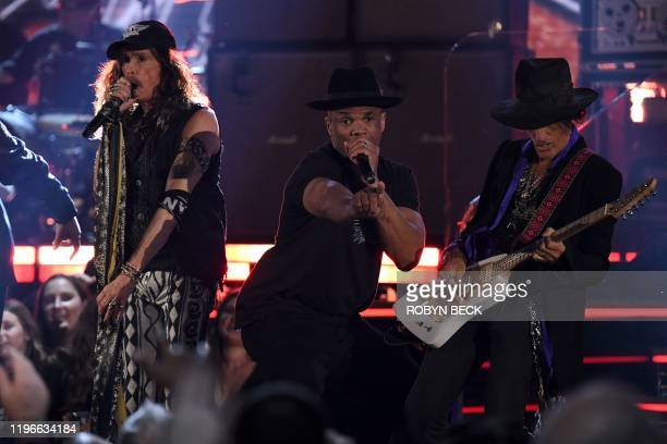 US singersongwriter Steven Tyler and guitarist Joe Perry of Aerosmith and Darryl McDaniels of Run DMC perform during the 62nd Annual Grammy Awards on...
