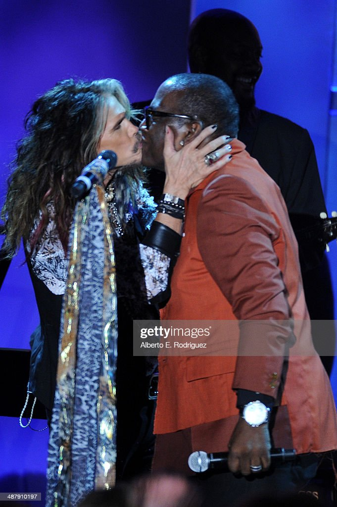 Singer/songwriter Steven Tyler (L) and TV personality Randy Jackson speak onstage during the 21st annual Race to Erase MS at the Hyatt Regency Century Plaza on May 2, 2014 in Century City, California.