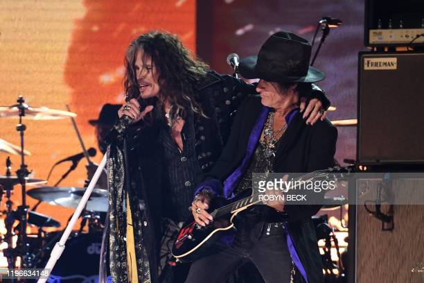US singersongwriter Steven Tyler and US guitarist Joe Perry of Aerosmoth perform during the 62nd Annual Grammy Awards on January 26 in Los Angeles