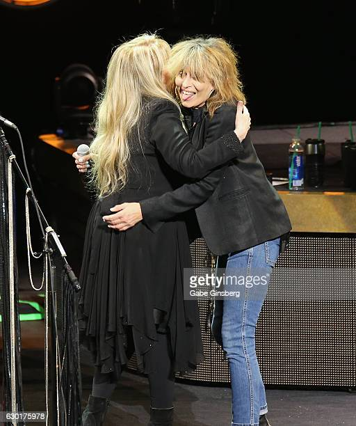 Singer/songwriter Stevie Nicks hugs recording artist Chrissie Hynde of The Pretenders during the grand opening of Park Theater at Monte Carlo Resort...