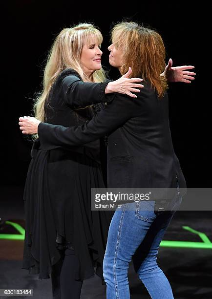 Singer/songwriter Stevie Nicks hugs recording artist Chrissie Hynde of The Pretenders as they perform during the grand opening of Park Theater at...