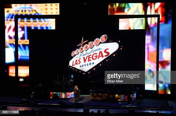 Singer/songwriter Stevie Nicks performs in front of an image of the Welcome to Fabulous Las Vegas sign during the grand opening of Park Theater at...