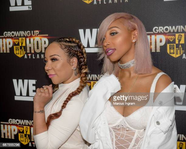 Singersongwriter Tameka 'Tiny' Harris and daughter Zonnique Pullins attend the 'Growing Up Hip Hop Atlanta' premiere at Woodruff Arts Center on May...