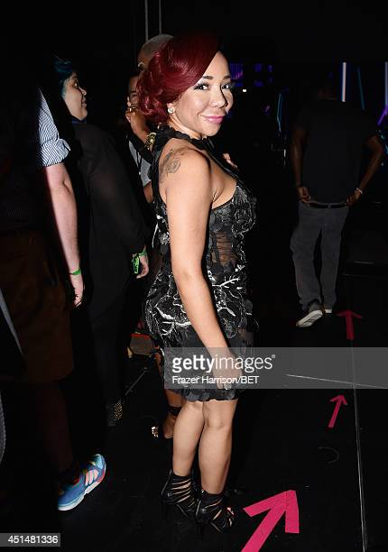 Singersongwriter Tameka 'Tiny' Harris attends the BET AWARDS '14 at Nokia Theatre LA LIVE on June 29 2014 in Los Angeles California