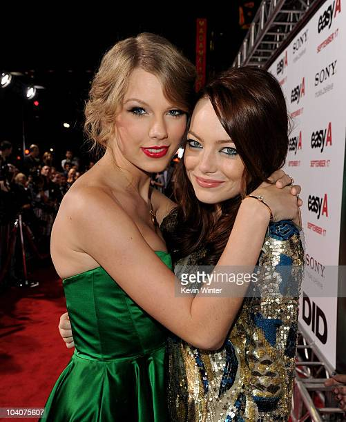 Singer/songwriter Taylor Swift and actress Emma Stone arrive at the premiere of Screen Gems' 'Easy A' at the Chinese Theater on September 13 2010 in...