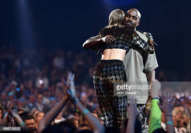 Singersongwriter Taylor Swift and rapper Kanye West hug onstage during the 2015 MTV Video Music Awards at Microsoft Theater on August 30 2015 in Los...