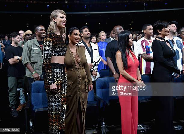 Singersongwriter Taylor Swift and tv personalities Kim Kardashian Kourtney Kardashian and Kris Jenner in the audience during the 2015 MTV Video Music...