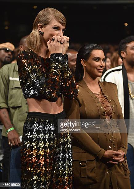 Singersongwriter Taylor Swift and TV personality Kim Kardashian in the audience during the 2015 MTV Video Music Awards at Microsoft Theater on August...
