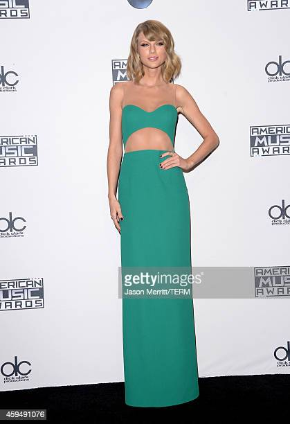 Singer/songwriter Taylor Swift poses in the press room at the 2014 American Music Awards at Nokia Theatre LA Live on November 23 2014 in Los Angeles...