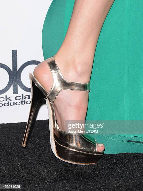 Singer/songwriter Taylor Swift winner of the inaugural Dick Clark Award for Excellence poses in the press room at the 2014 American Music Awards at...