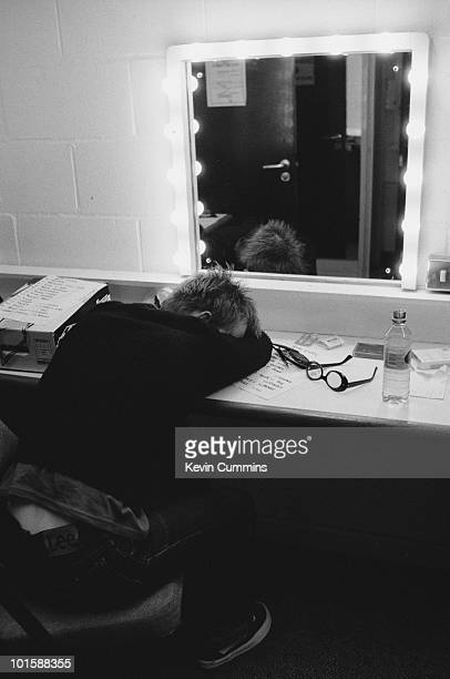 Singersongwriter Thom Yorke of British band Radiohead relaxes backstage at the Corn Exchange in Cambridge England on November 06 1995