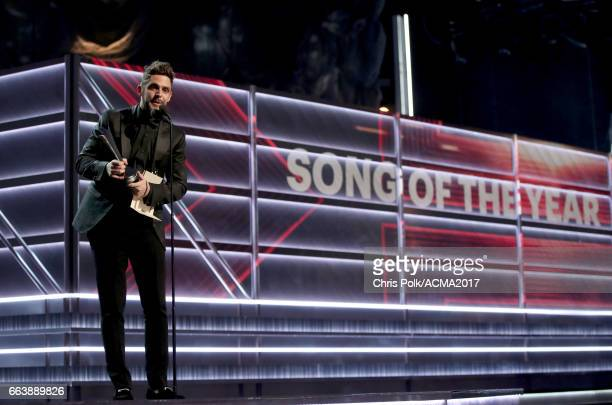 Singersongwriter Thomas Rhett accepts the award for Song of the Year onstage during the 52nd Academy of Country Music Awards at TMobile Arena on...