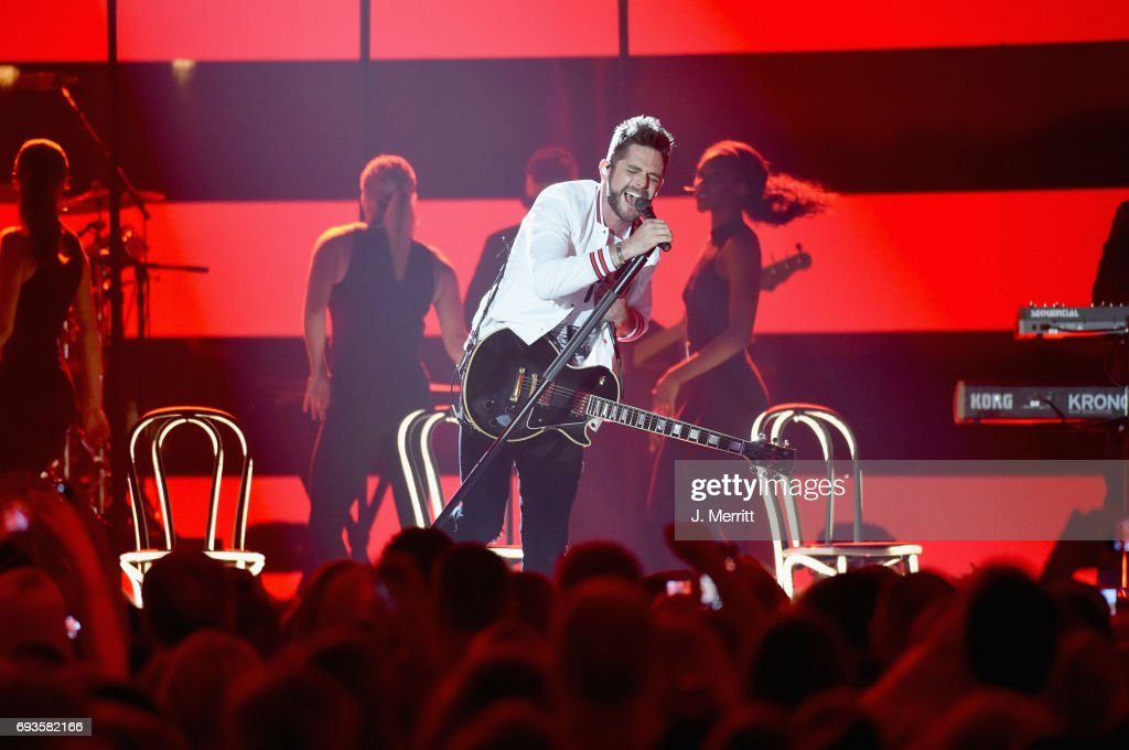 Singer-songwriter Thomas Rhett performs onstage at the 2017 CMT Music Awards at the Music City Center on June 7, 2017 in Nashville, Tennessee.