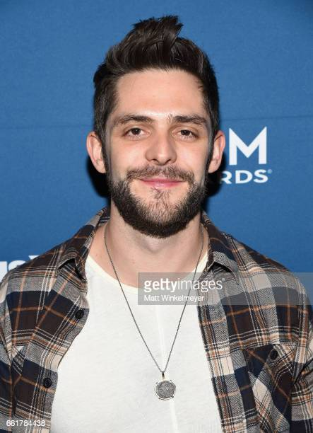 Singersongwriter Thomas Rhett poses with SiriusXM's The Highway Channel as they broadcast backstage leading up to the American Country Music Awards...
