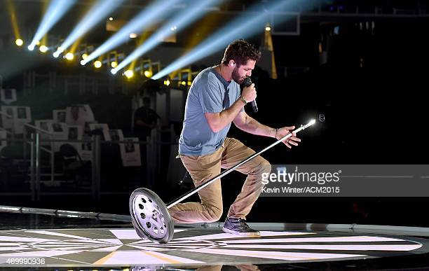 Singer/songwriter Thomas Rhett rehearses onstage during the 50th Academy of Country Music Awards at ATT Stadium on April 16 2015 in Arlington Texas
