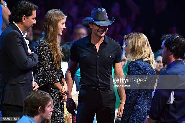 Singersongwriter Tim McGraw and Host Erin Andrews talk during the 2016 CMT Music awards at the Bridgestone Arena on June 8 2016 in Nashville Tennessee