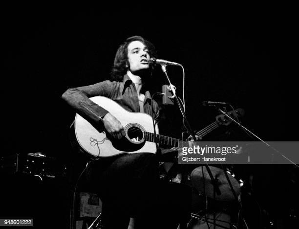Singersongwriter Tim Moore performs on stage in Amserdam Netherlands December 1975