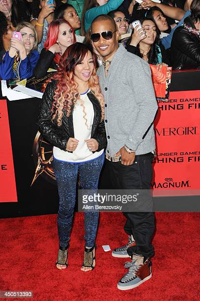 """Singer/songwriter Tiny and rapper T.I. Arrives at the Los Angeles Premiere of """"The Hunger Games: Catching Fire"""" at Nokia Theatre L.A. Live on..."""