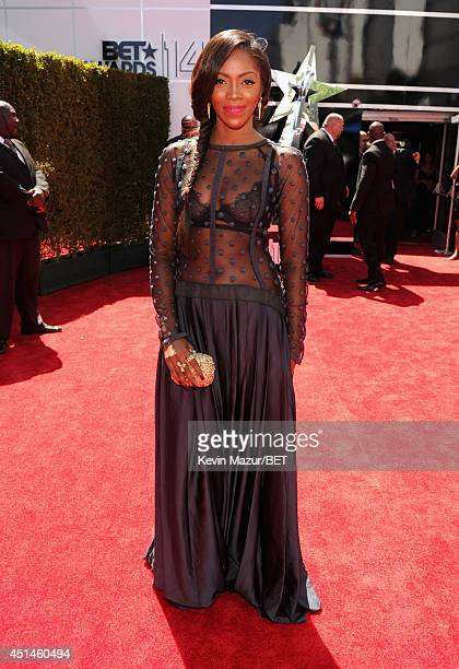 Singersongwriter Tiwa Savage attends the BET AWARDS '14 at Nokia Theatre LA LIVE on June 29 2014 in Los Angeles California