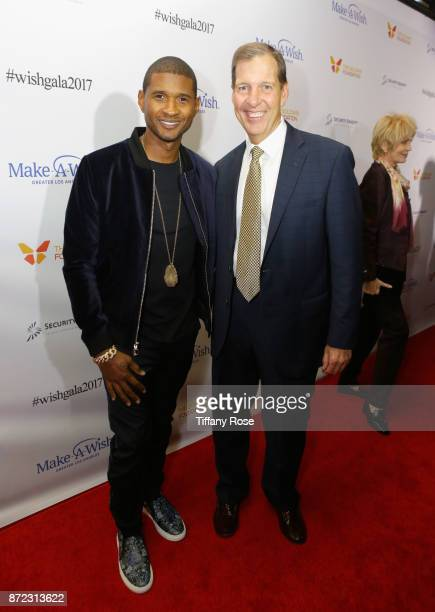 Singersongwriter Usher and MakeAWish Foundation CEO Neil Aton at the 2017 Make a Wish Gala on November 9 2017 in Los Angeles California