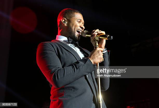 Singersongwriter Usher performs on stage at the Samsung Pay New Year's Eve Party at The Fonda Theatre on December 31 2015 in Los Angeles California