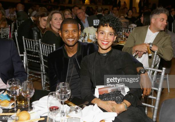 Singersongwriter Usher Raymond IV and Grace Miguel at the 2017 Make a Wish Gala on November 9 2017 in Los Angeles California